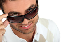 man-holding-his-sunglasses-22063543